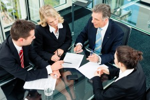 Business - meeting in an office; the businesspeople are discussi