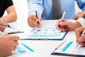 Close-up of businessman explaining a financial plan to colleague